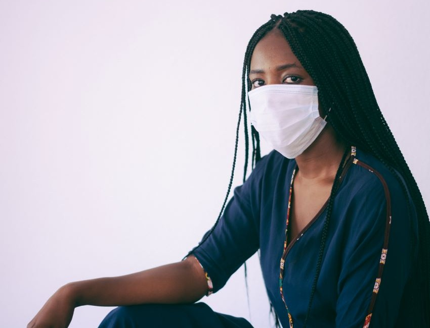 woman suffering from COVID-19 wearing mask