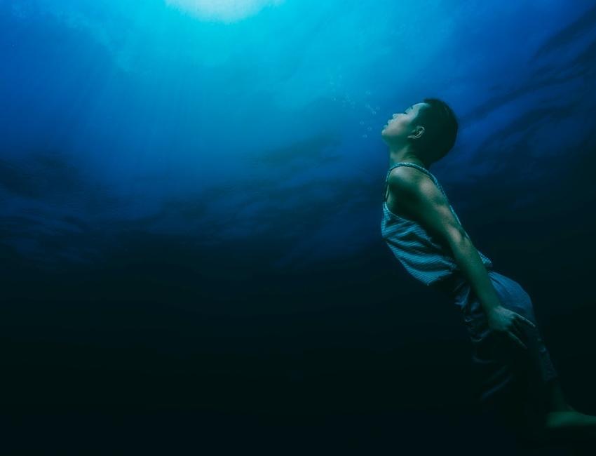 Person holding their breath underwater