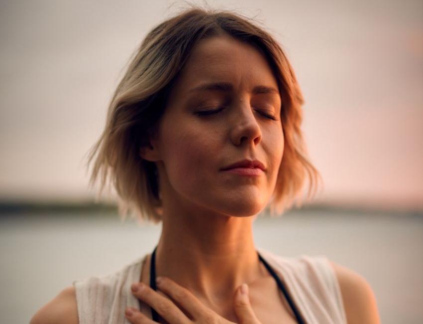Woman taking deep breaths to calm herself