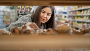 Woman reach for baked goods at market