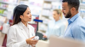 Pharmacist talking to customer about supplements
