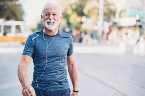 Older man walking outside