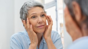 Mature woman looking at self in mirror