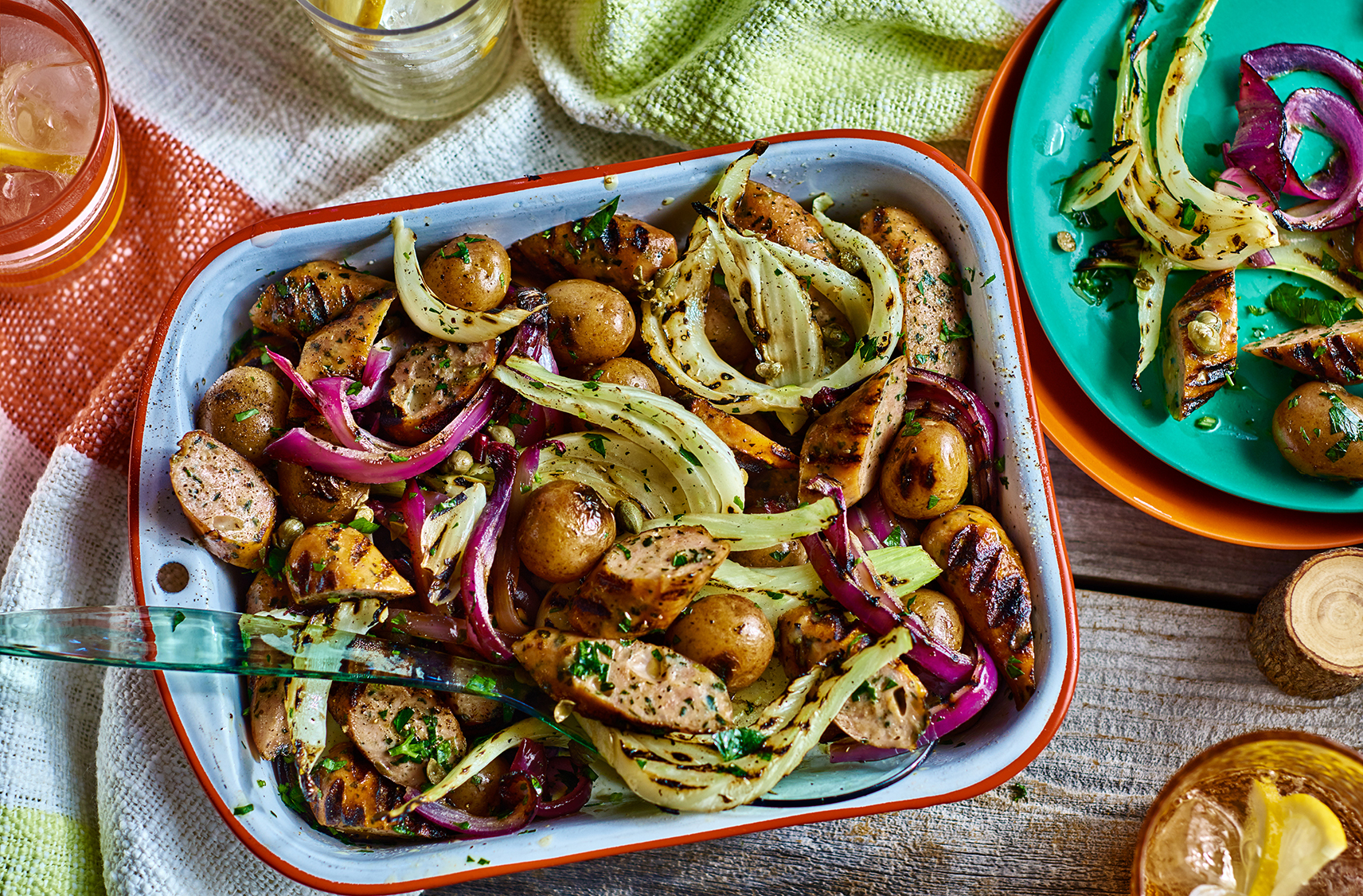 A platter of grilled sausage and potato salad with fennel and onions