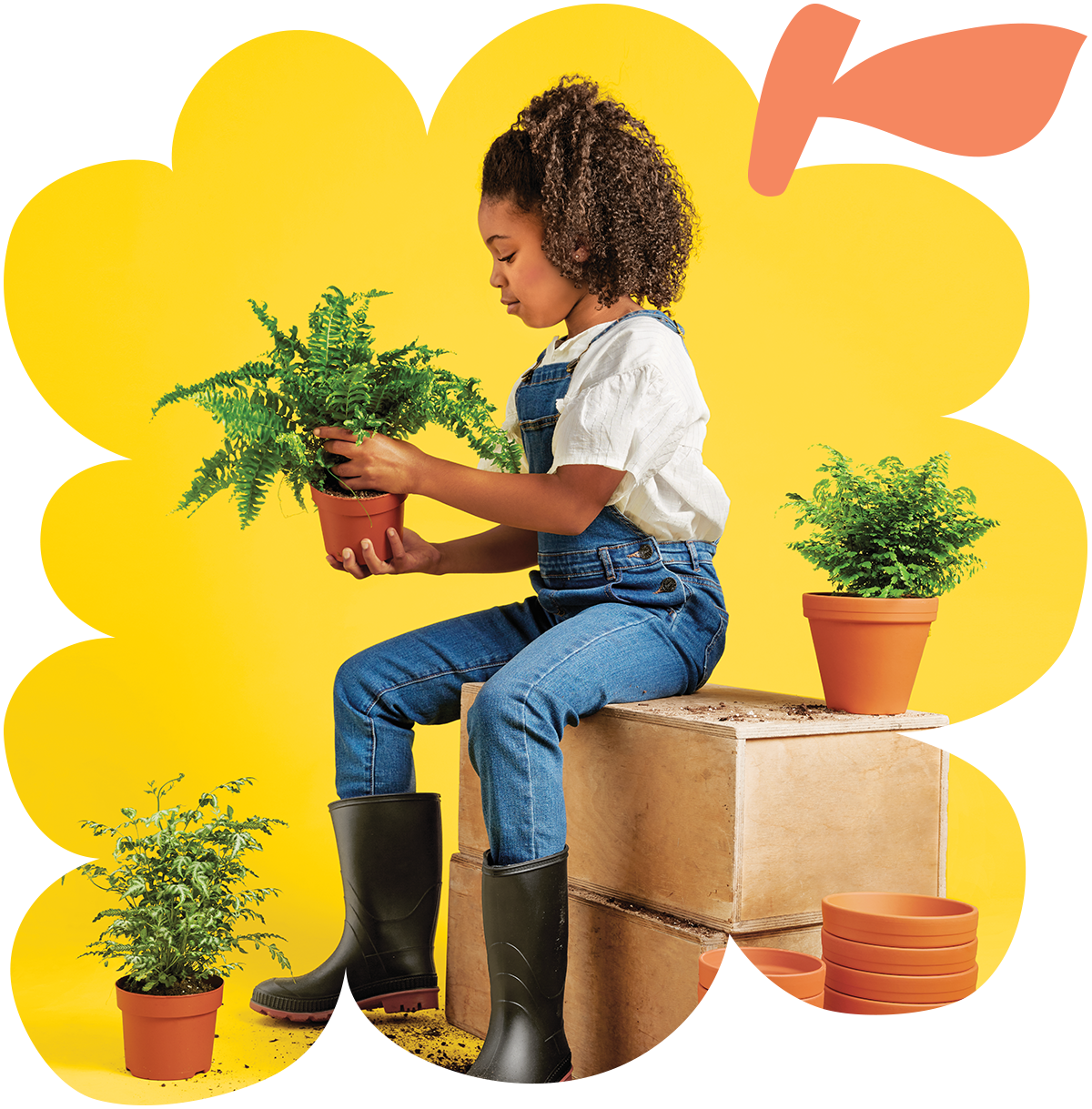 A young girl potting plants sitting on wooden blocks in the background of an animated image of grapes.