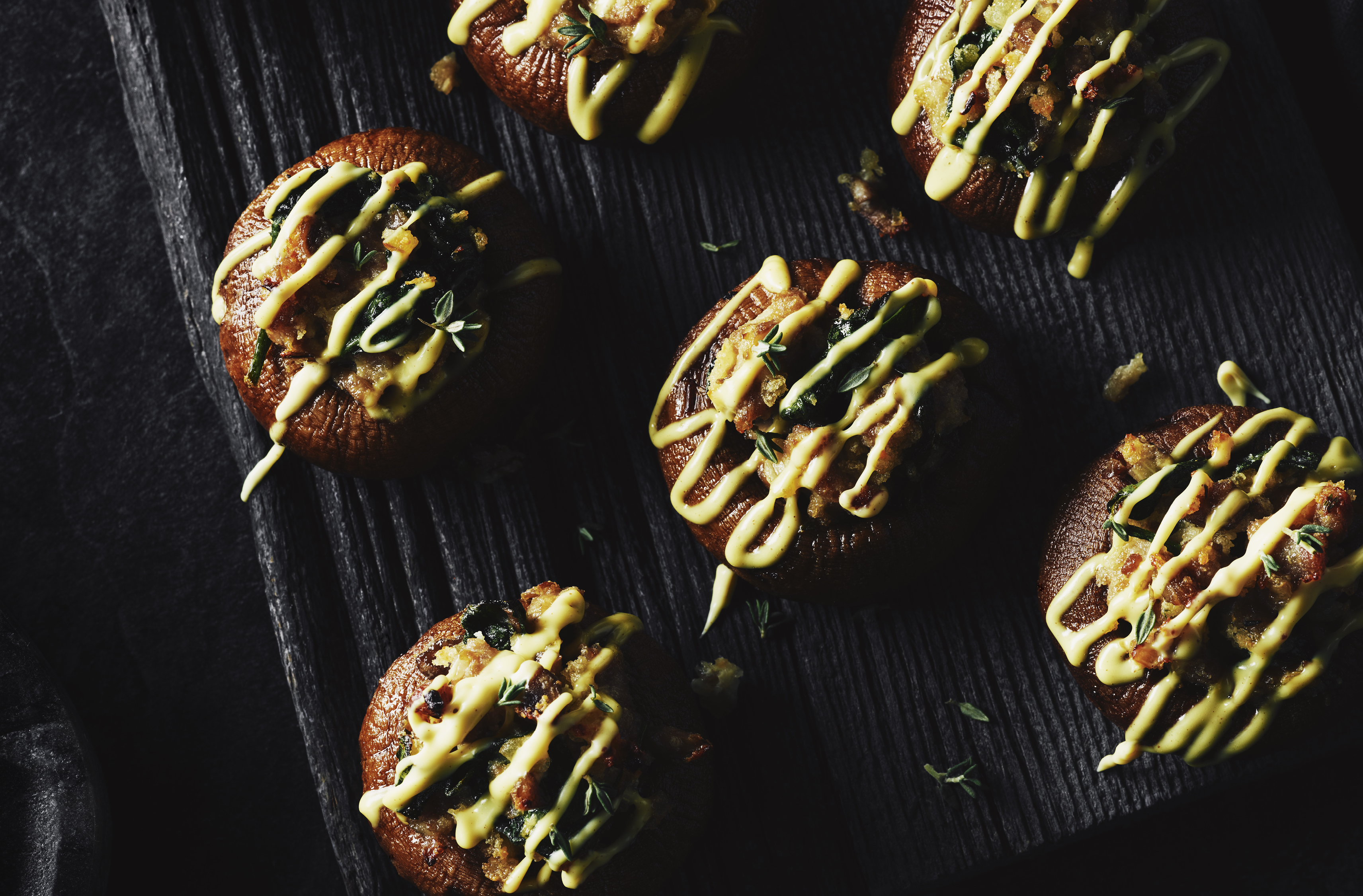 Sausage - stuffed mushroom caps drizzled with hollandaise sauce