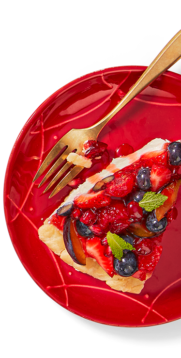 A slice of fruit topped dessert