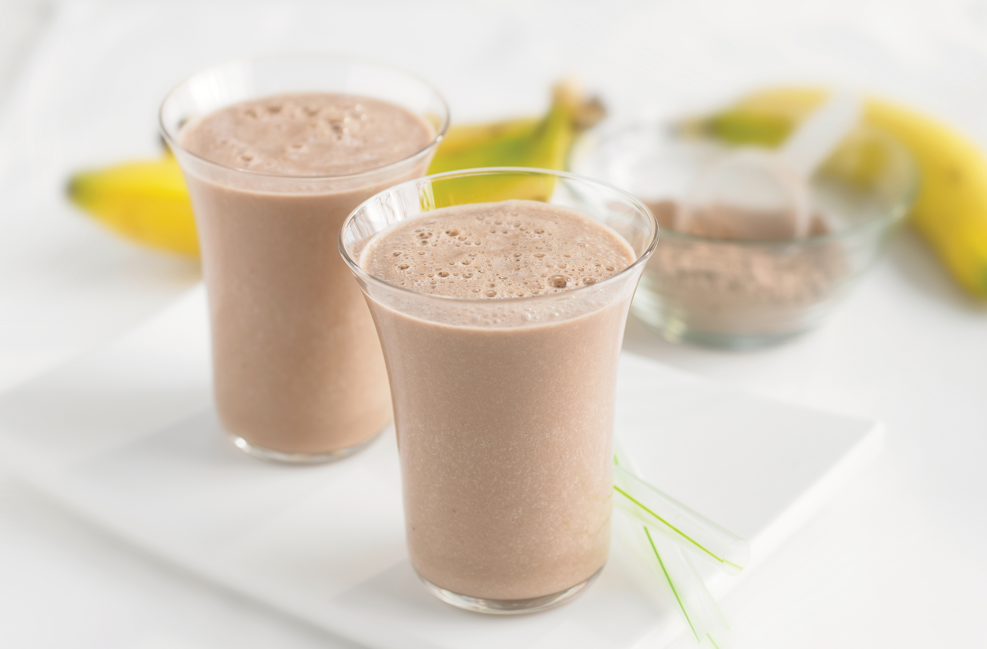 2 glasses of chocolate banana soy breakfast protein shake