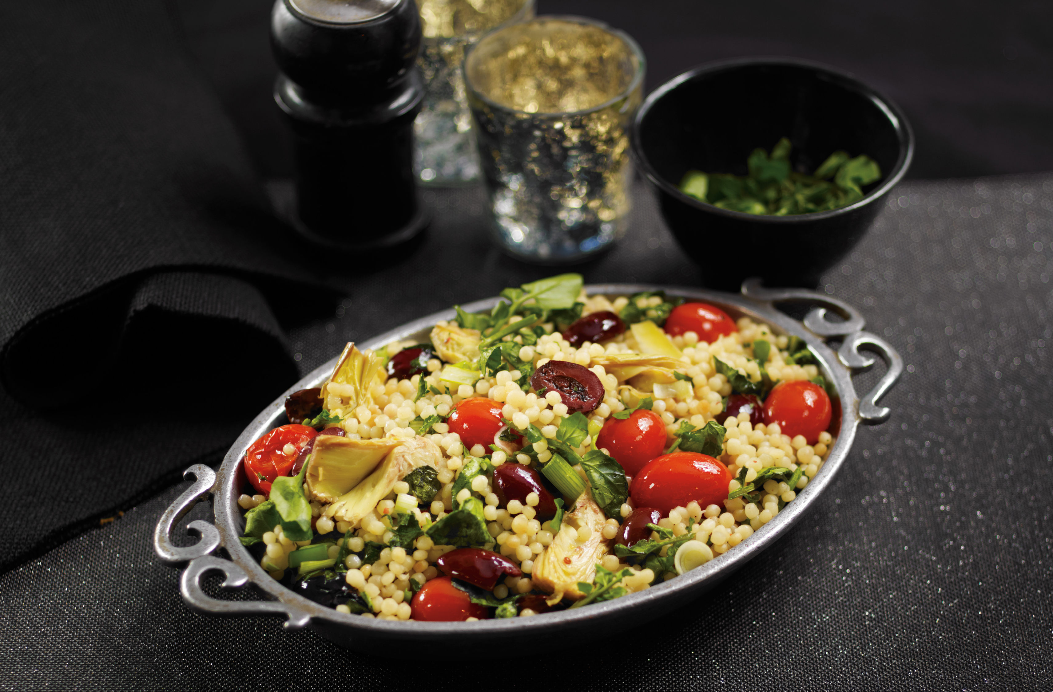 Couscous with  tomatoes, black olives, chopped artichoke hearts, watercress
