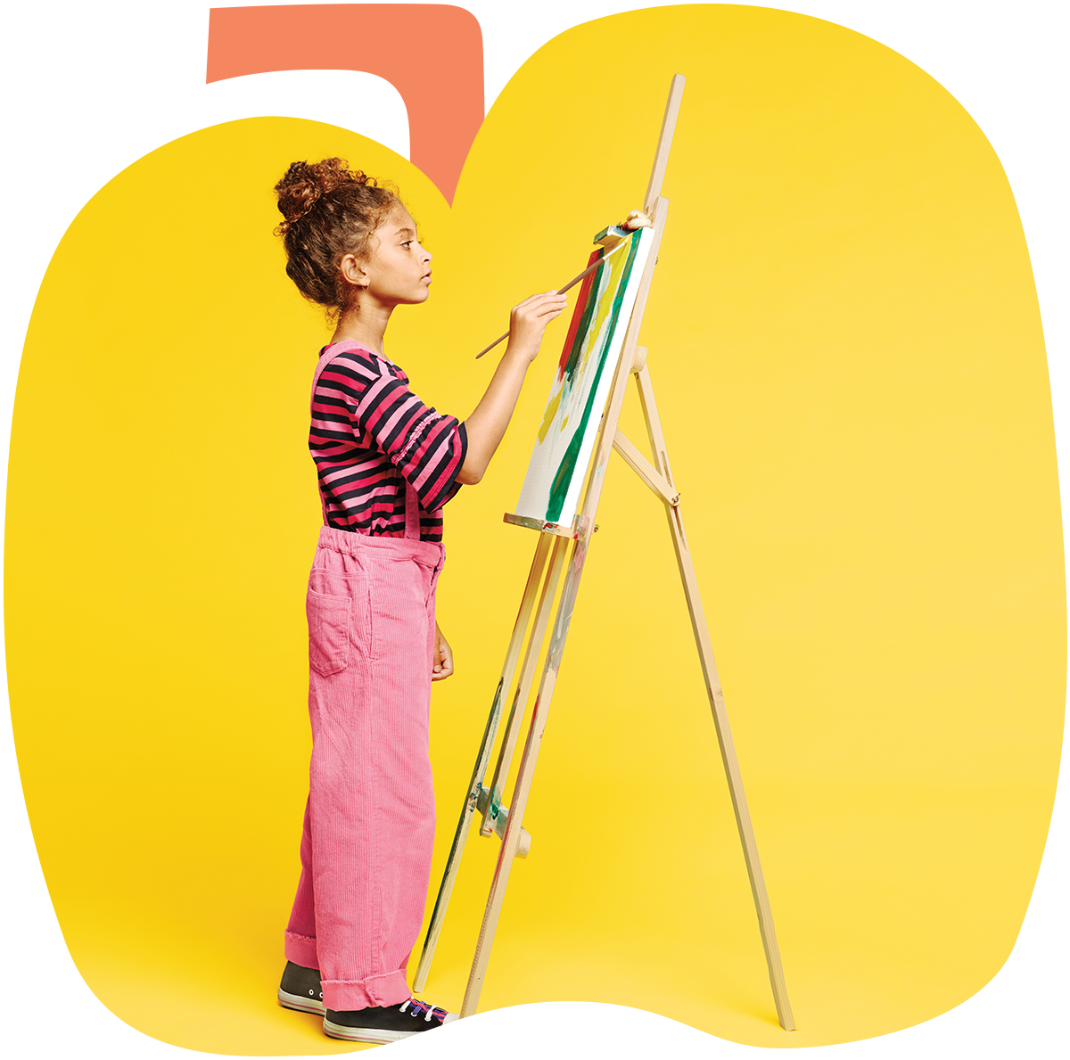 A young girl creating art on an easel in the background of an animated image of an apple