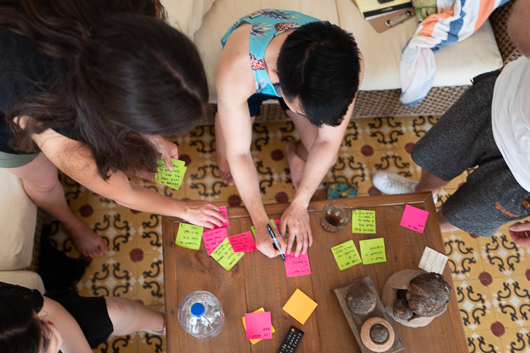 A group of cLabbers using sticky notes