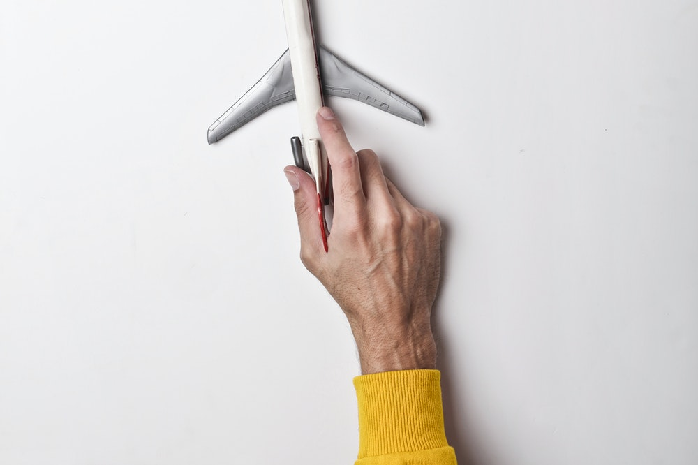Holding a toy plane