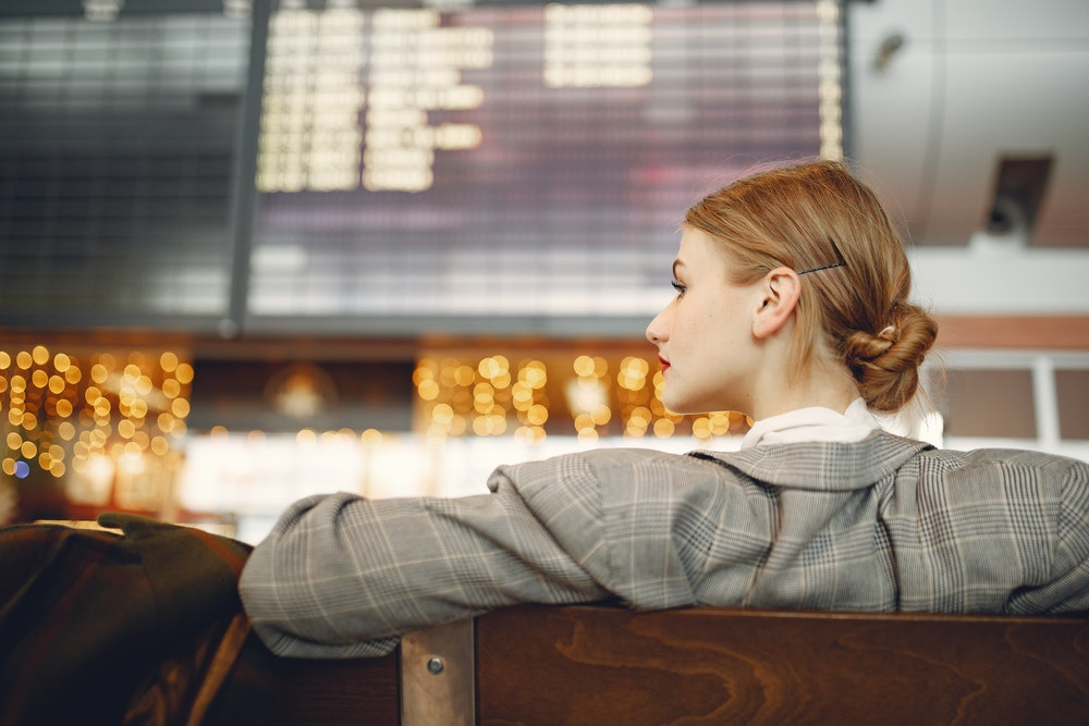 Young woman waiting for a flight at the airport