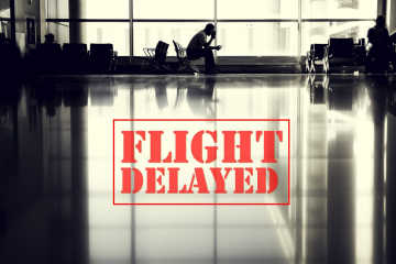 Flight is delayed sign