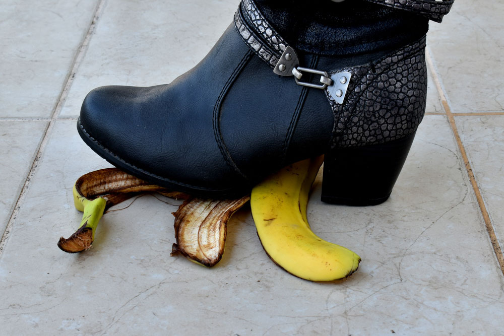 Woman stepping on banana skin