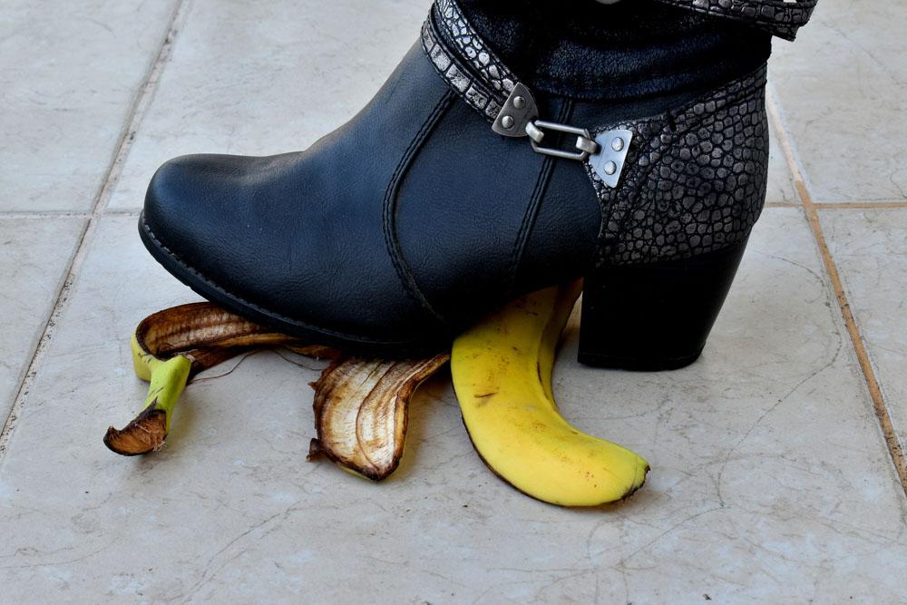 Woman stepping on banana skin