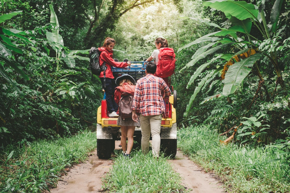 Jeep and people in the jungle