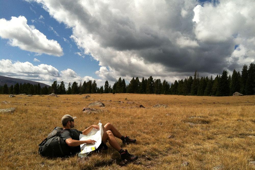 Traveler lying on the grass