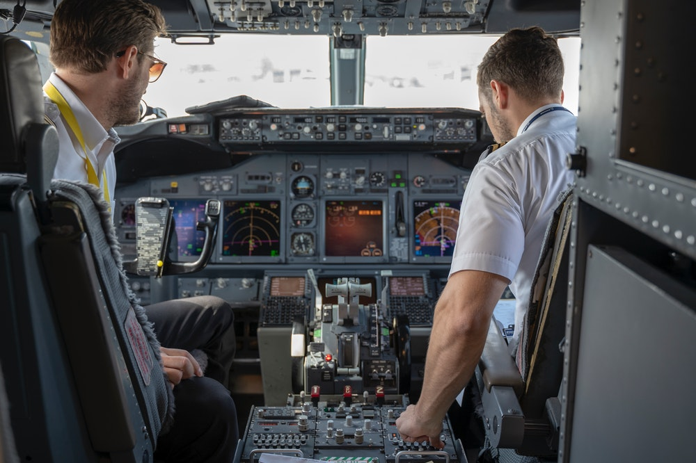 Two pilots on an airplane