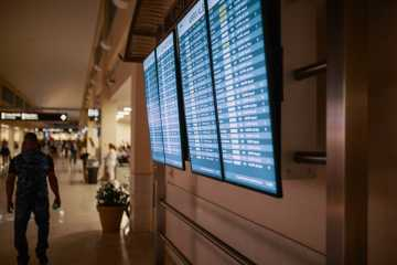 Flight information screens at the airport