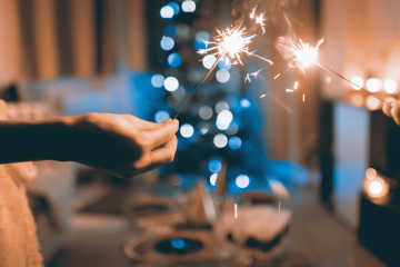 Sparklers held in hands, during the Christmas time