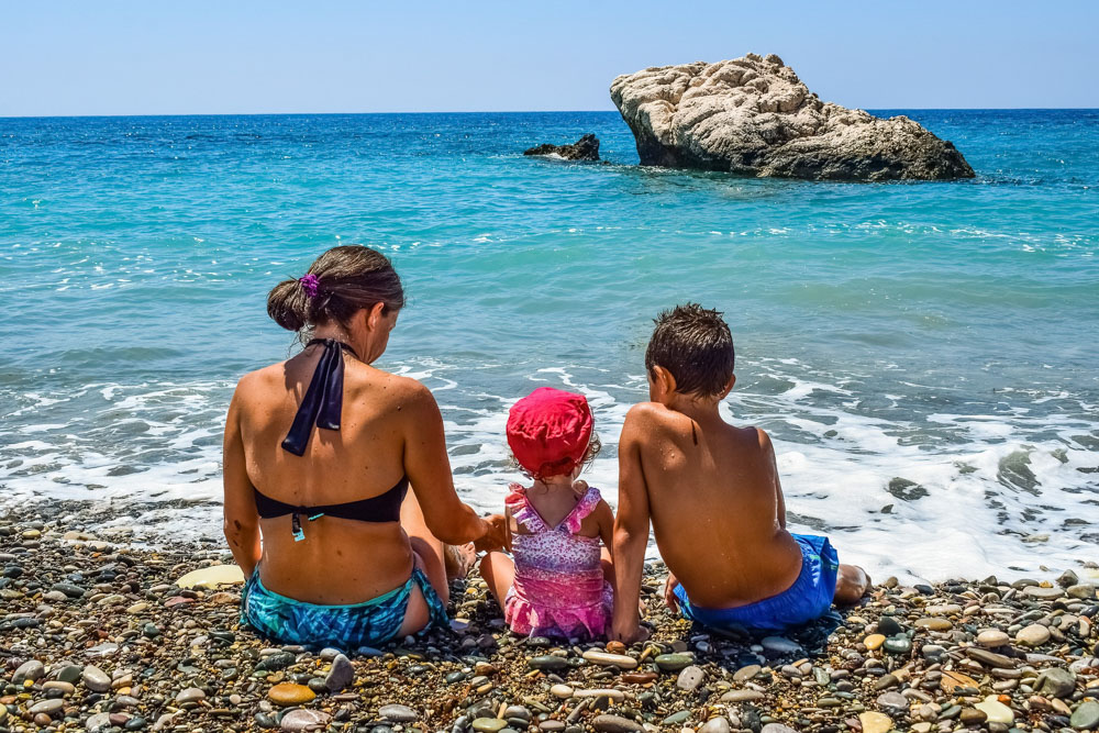 Woman and two kids on the beach