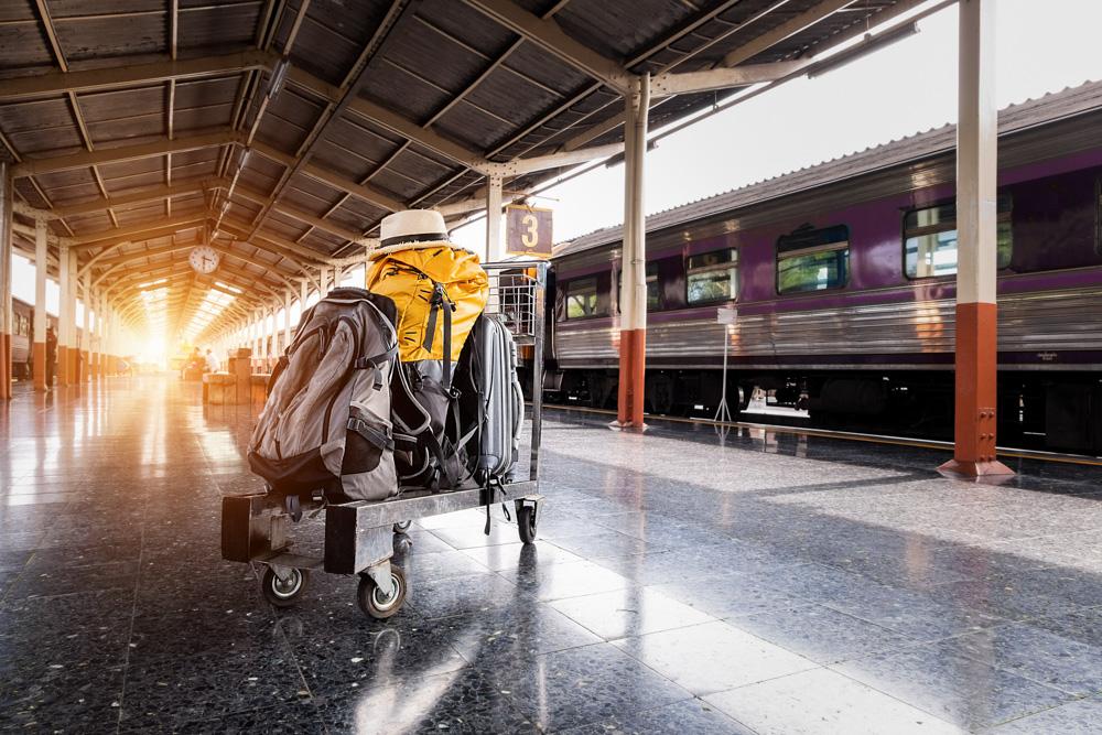 Luggage on a trolley in train station
