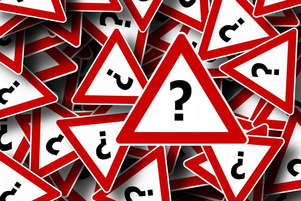 Question marks road signs