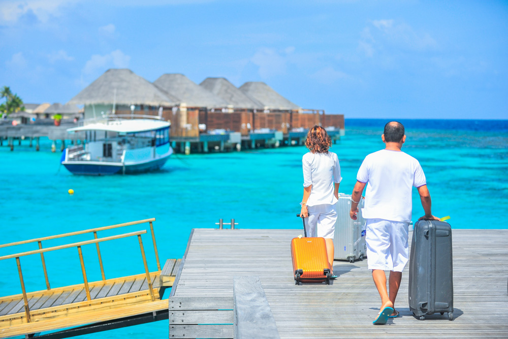 Two people on the pier - Traveller checklist for holiday