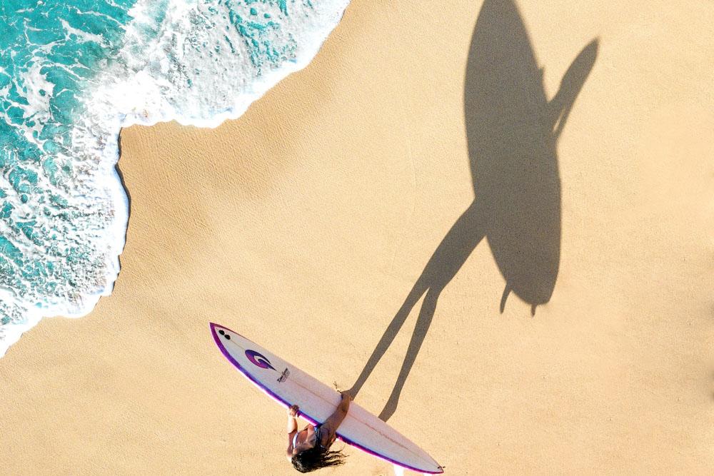 A surfer on the beach