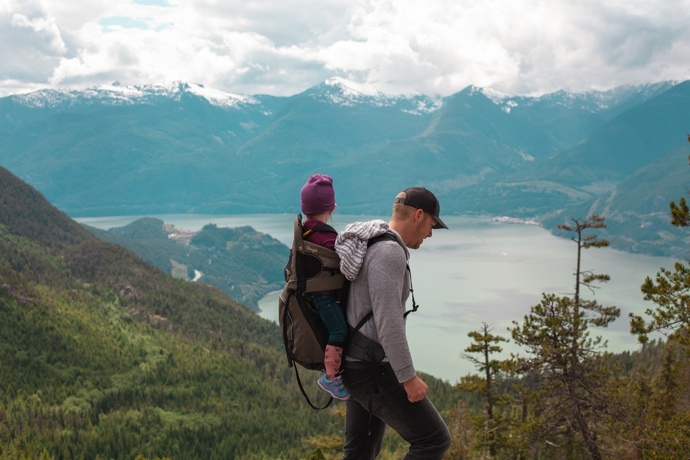 A man hiking with a kid