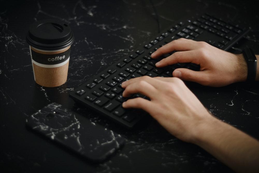 Writing on black keyboard
