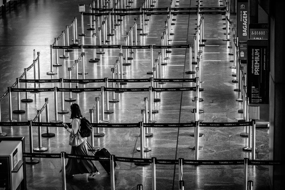 Woman walking in an empty airport