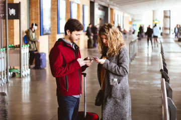 Man and woman at the airport - What to do if your flight is cancelled
