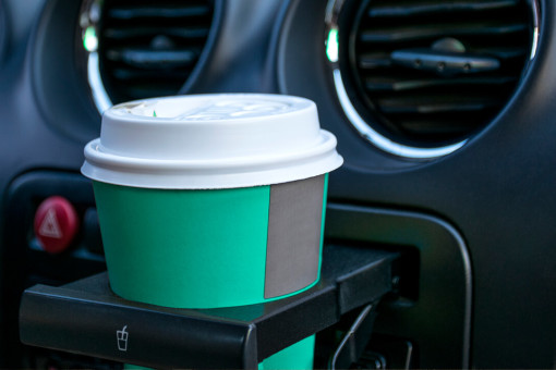 Coffee cup in car cup holder
