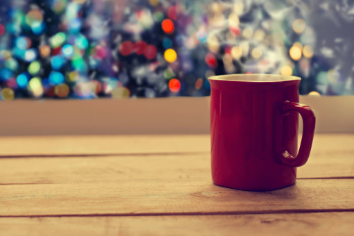 Cup of tea with Christmas lights in the background