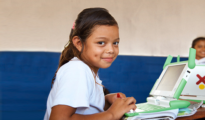 A school child at her desk in a classroom