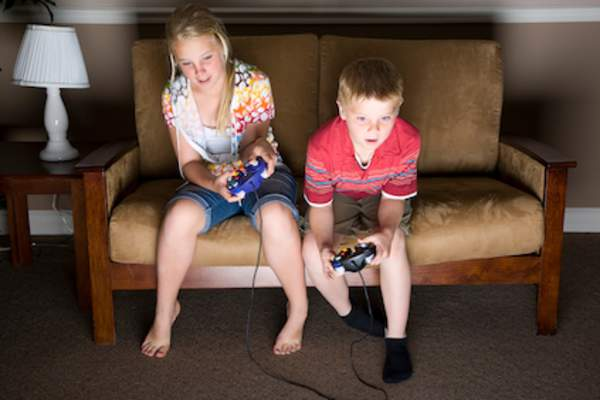 Brother and sister playing video game.