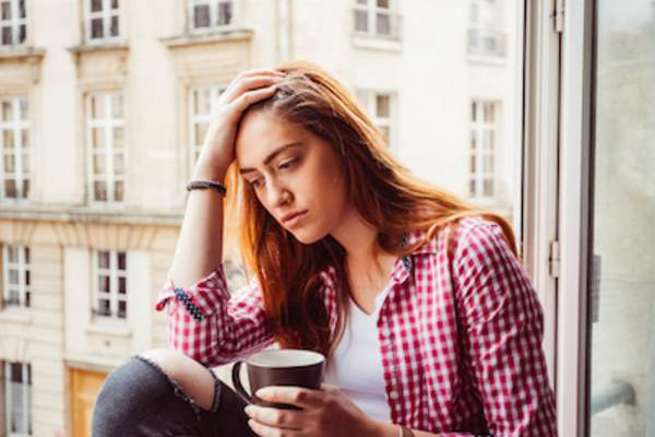 Depressed woman lack of sleep, looking out window
