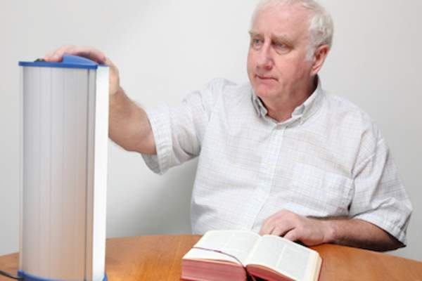 Man adjusting his light box