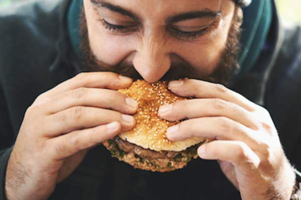 Man eating a hamburger.