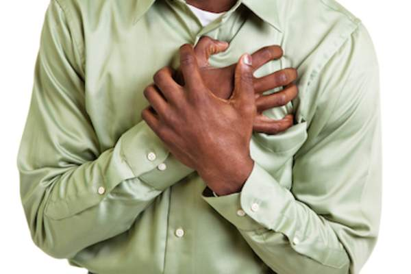 Man clutching at chest.