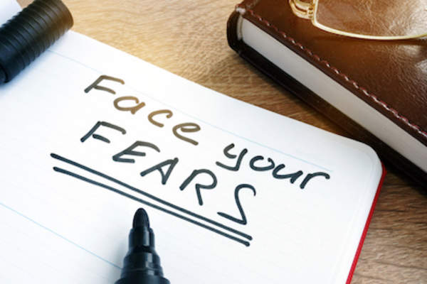 """Face your FEARS"" written in notebook."