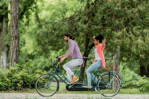 Couple on tandem bicycle.
