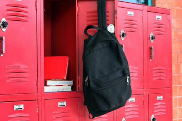 Backpack hanging on open locker
