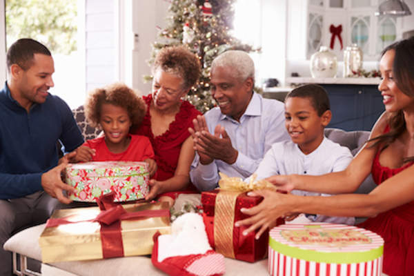 Opening gifts with grandkids is a priority event.