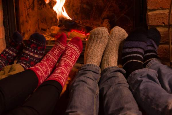 feet in warm socks in front of fireplace