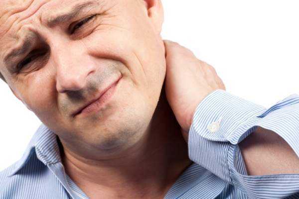 Man holding neck
