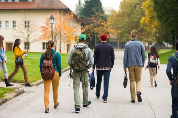 Group of young adults walking to college classes.