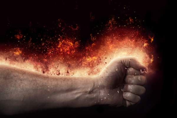 Arm and hand on fire, burning sensation concept.